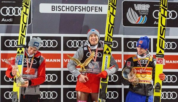 (L to R) Piotr Zyla of Poland, Kamil Stoch of Poland and Daniel Andre Tande of Norway pose with their trophies on the podium of the Four Hills tournament's overall winners after the final stage of the 65th Four Hills Tournament (Vierschanzentournee) ski jumping event in Bischofshofen, Austria, on January 6, 2017. / AFP / APA AND EXPA / JFK / Austria OUT
