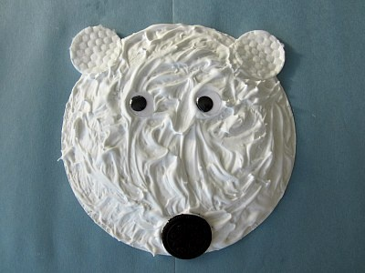 Puffy paint polar bears (glue and shaving cream on paper plates)… I wonder how my kids would handle this…?