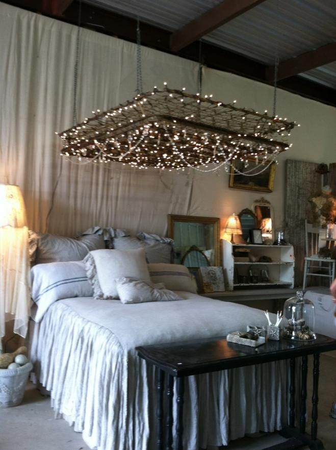 An old mattress wire frame is an unexpected and dazzling bedroom lighting idea.   Photo:  mrsolearysart.blogspot.com