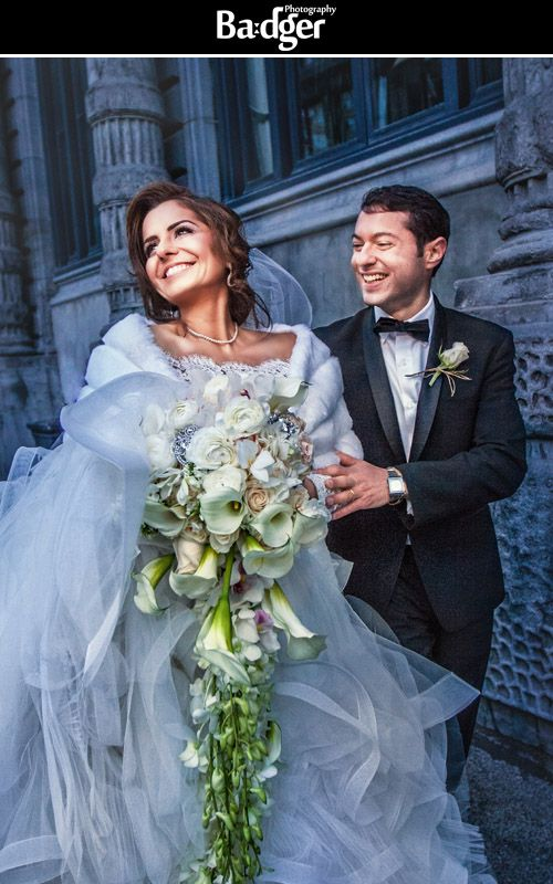 We love incorporating some of Old Montreal's beautiful architecture in our shots. Lovely shot of a beautiful couple in Love (with a capital L!). Bride in a stunning dress with a massive and long bouquet! Now that's a bouquet you don't see every day... Wedding photography by Badger Photography - http://badgerphotography.ca