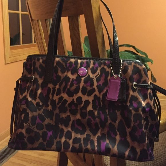 Coach shoulder bag Black, tan, and purple animal print Coach bag. Gently used. Great condition! Coach Bags Shoulder Bags