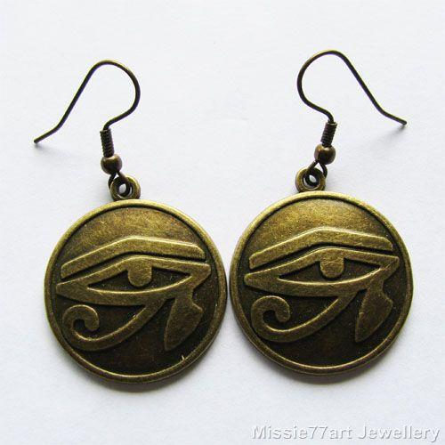 Eye of Horus Wadjet eye earrings in gold plated metal available from Missie77art Jewellery ebay