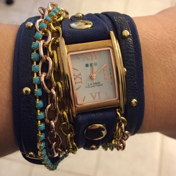 La Mer leather studded bracelet watch This is a very pretty La Mer Collections wrap watch. If you're not familiar with this brand, it's a high end watch brand sold at Nordstrom, Saks, and other luxe retailers. It's made of genuine navy blue leather with gold toned studs. It also features gold, rose gold, and turquoise stud bracelets attached to it. Watch case size is 19mm. It has been worn a handful of times and although you can tell its not brand new, it's in very good condition. Battery…
