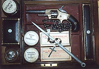 These kits were reported to have been sold in some central European hotels and at the Great Exhibition in London of 1851. This one comes complete with revolver, silver bullets manufactured by Belgian gunsmith Nicolas Plomdeur, garlic powder, silver dagger, ivory cross, mirror, Professor Blomberg's New Vampire Serum and wooden stake etc. in a mahogany box.