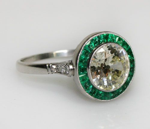 Vintage Maria Perez emerald and diamond engagement-ring with channel set emeralds and large brilliant cut pale yellow diamond