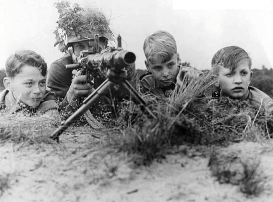 Boys of the Hitler Jugend training with a MG 34, June 14, 1943