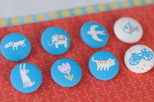 Blue screenprinted fabric buttons, by ana aceves