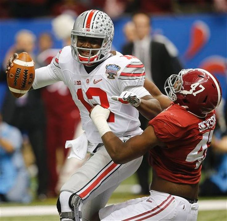 Ohio State quarterback Cardale Jones (12) is sacked by Alabama linebacker Xzavier Dickson (47) in the first half of the Sugar Bowl NCAA college football playoff semifinal game, Thursday, Jan. 1, 2015, in New Orleans. (AP Photo/Bill Haber)