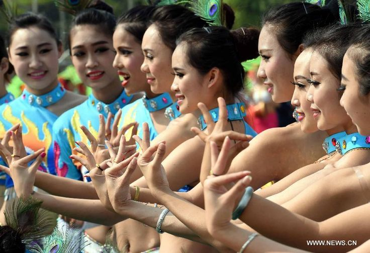 Girls of Dai ethnic group perform peacock dance during a cultural demonstration to celebrate the New Year of Dai ethnic group in Jinghong City, Dai Autonomous Prefecture of Xishuangbanna, Yunnan Province, April 14, 2015. Over 5,000 local people took part in the demonstration, presenting traditional arts and dances http://www.chinatraveltourismnews.com/2015/04/new-year-of-dai-ethnic-group-celebrated.html