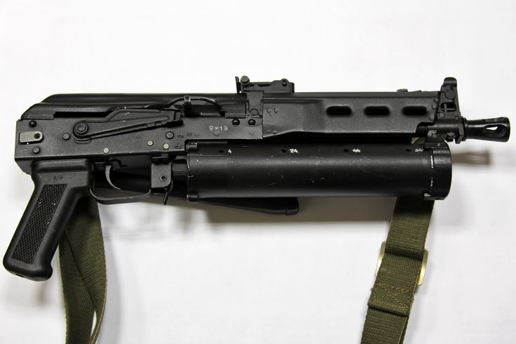 Bizon SMG, 9x19mm parabellum with 64 round helical magazine. Modeled after the AK family.