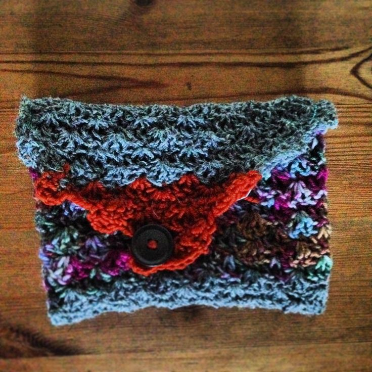 crochet clutch, purple, brownish and grey, the lining is made from up-cycled material, soft to the touch this clutch is very unique.