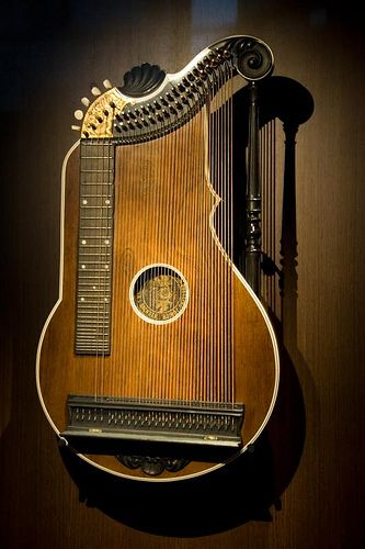 this instrument is currently hanging in a museum and is one of the only harp/dulcimer created in the world.
