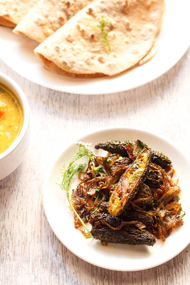 bharwan karela - a dry stuffed bitter melon curry with indian spice ...