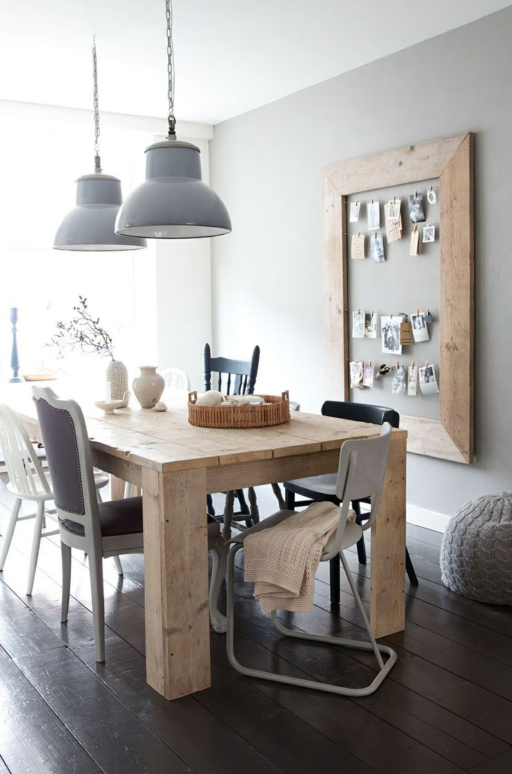 Rustic and chunky dining table, industrial pendants, mismatched chairs and fab picture frame peg board