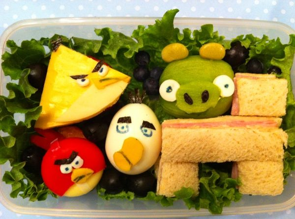 A mother made artistic lunches for her child. This one is an angry bird inspired lunch. She must have an abundance of time :)