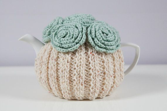 Cream coloured hand knitted tea cosy