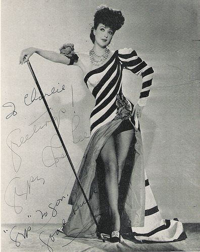 GYPSY ROSE LEE!  Gypsy Rose Lee (January 9, 1911[1] – April 26, 1970) was an American burlesque entertainer famous for her striptease act. She was also an actress, author, and playwright whose 1957 memoir was made into the stage musical and film Gypsy.