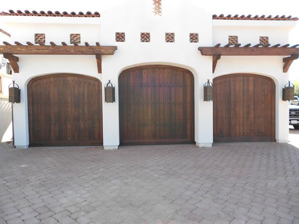 These garage doors in San Diego were designed to complement the Spanish Revival…