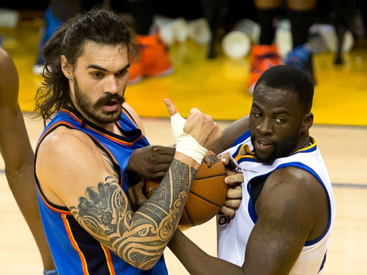 Oklahoma City Thunder center Steven Adams (12) and Golden State Warriors forward Draymond Green (23) battle for the ball during the second quarter in game seven of the Western conference finals of the NBA Playoffs at Oracle Arena. Kelley L Cox, USA TODAY Sports