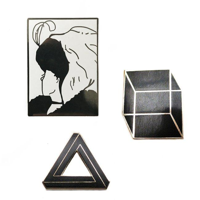 Get each of our optical illusion pins at a discount!  The Penrose Triangle, Necker Cube, and old maid illusion.