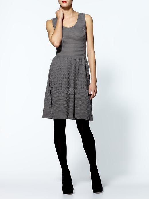 Little Grey Dress :-)  Add woolen tights, boots and a thick sweater for a casual day outfit, or stilettos and a cropped blazer or leather blouson for date night.