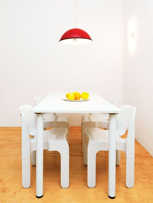 Four Universale Stacking Chairs By Joe Colombo For Vitra Flank A White Plastic Table In
