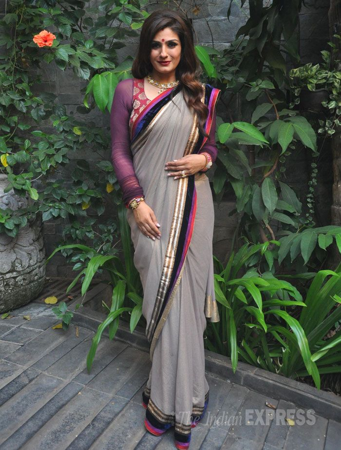 Raveena Tandon looked beautiful in a grey sari with a bright purple blouse as she celebrated Diwali at her Mumbai residence. #Bollywood #Fashion #Style #Beauty