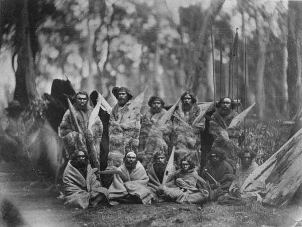 Group of Aborigines, sitting and standing, whole-length, full face, wearing animal skins, some holding weapons' Richard Daintree and Antoine Fauchery, circa 1858, State Library of Victoria,