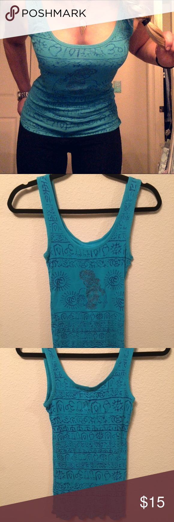 FREE PEOPLE Turquoise Aztec Tank Top Women's Free People tank top in a size small. Turquoise color with dark blue design/symbols and glitter accents. In excellent condition, with no stains, holes, rips, or fading. Free People Tops Tank Tops