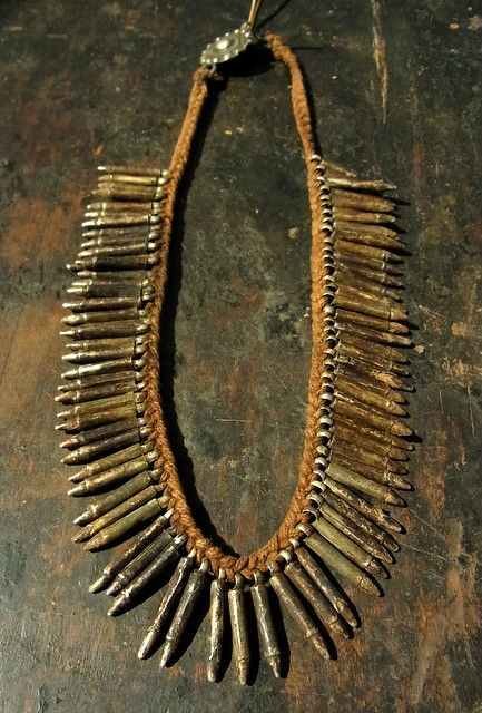 Nepal | Old Amulet Necklace from Tharu people. Terai jungle area, south Nepal |  Would have been worn as a talisman against evil by women and children | This style of necklace is very old.  The amulets are usually made up of bone/teeth or wood where only the tips are exposed, and the rest is covered with silver or far more commonly with a white metal  | ¥ 50,000