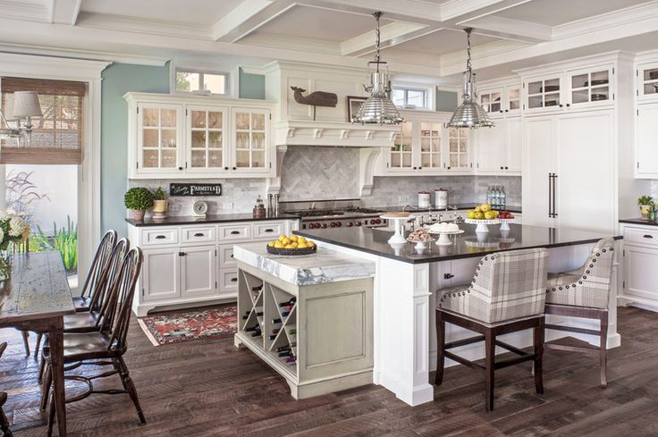 Beach Style Kitchen by Norman Design Group, Inc. - love this, especially the color on the walls