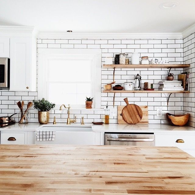 white subway tile farm sink brass open shelving kitchen.