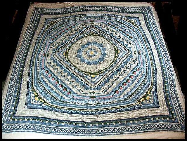 """My Sophie's Universe 4 done mainly in Lt Grey, Powder Blue, and Country Blue; 72"""" square. (Pattern by Dedri Uys) $300 at http://www.ritamiller.com/afghans/ar193.html."""