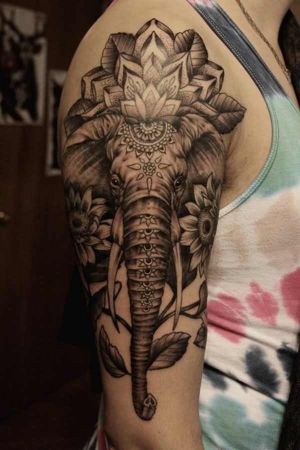 ... and grey indian elephant face with flowers tattoo on right half sleeve