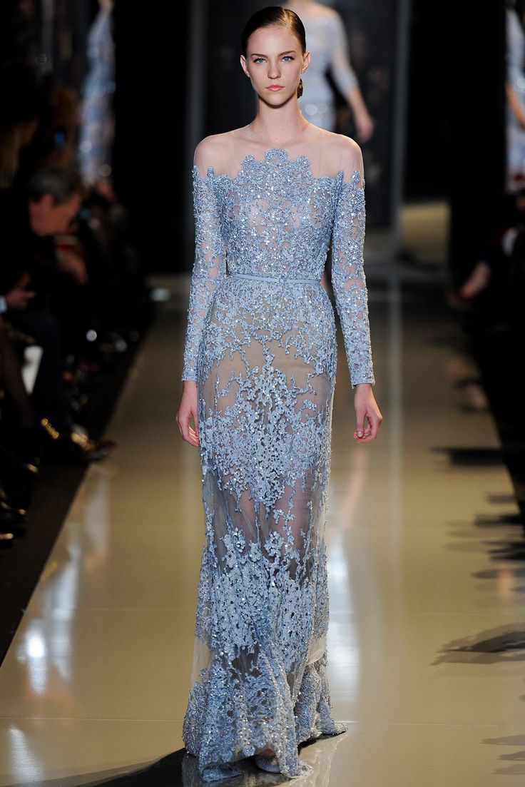 Elie Saab Spring 2013: I love the light ice blue color of this gown! There are ice blue embellishments on the long sleeves and skirt. The shoulders, neckline and parts of the skirt are sheer.