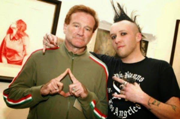 Robin Williams and... ?  Illuminati hand signs.