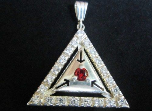 Sterling silver  triangel pendant with white zircons and red zircon.
