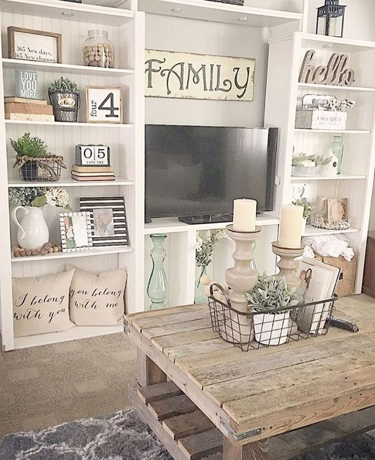 Such an adorable table. Love the centerpiece. The built ins are gorgeous. Love the way it's staged #farmhouse #farmhouselivingroom. #cozy