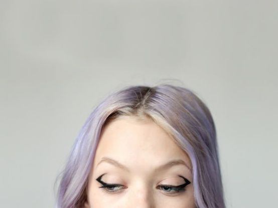 Geometric eyes and purple hair.