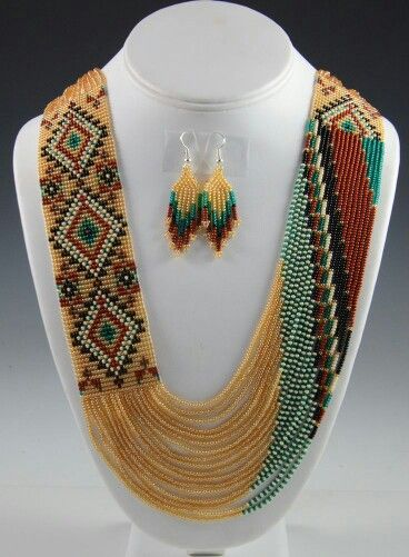 Wow that is a lot of work and likely to be heavy too!  Native American Indian style beaded necklace & earrings.