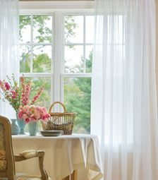 White Chiffon Curtains ... and flowers, of course. I like the whole look