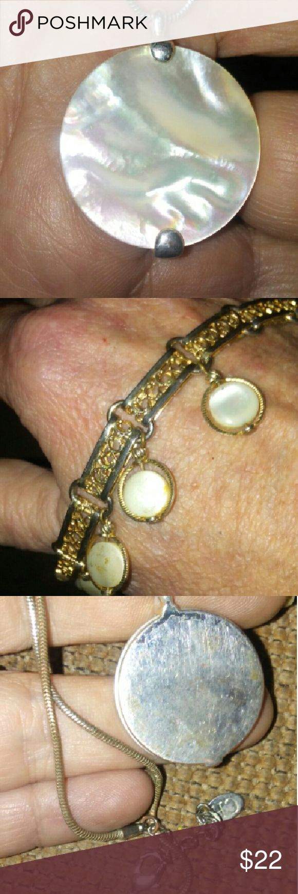 """MOP Necklace and vintage bracelet lot Georgeous mother of pearl circle 2"""" necklace on 13"""" chain marked CH. Back is shiny mirrored silver. Bracelet is vintage gild colored 8"""". There are 7 lil mop swivel circles on bracelet.. Both one price! Jewelry Necklaces"""