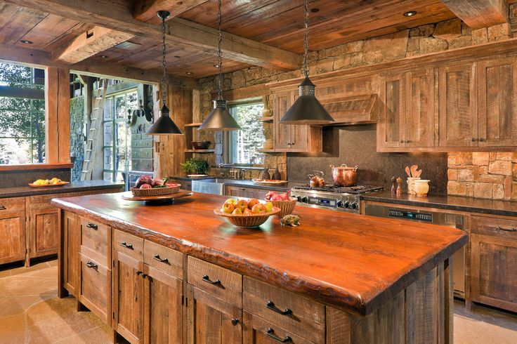 Elegant copper tea kettle in Kitchen Rustic with Rough Sawn Lumber next to Thick Quartz Countertops alongside White Springs Granite Slabs and Charging Drawer