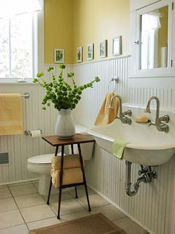 yellow bathroom—love the bead board and the sink.