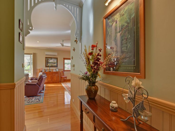Unusual to see wainscoting in Australian homes - beautifully polished timber floors, olive green wall, white fret-work arch with lots of light: 78 West Ridgley Road, Ridgley, Tas 7321