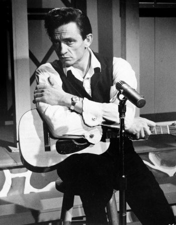 Johnny Cash:  Folsom Prison Blues, I Walk the Line, Don't Take Your Guns to Town, Tennessee Flat Top Box, Hey Porter, Big River, Get Rhythm, Man in Black, Give My Love to Rose, etc...
