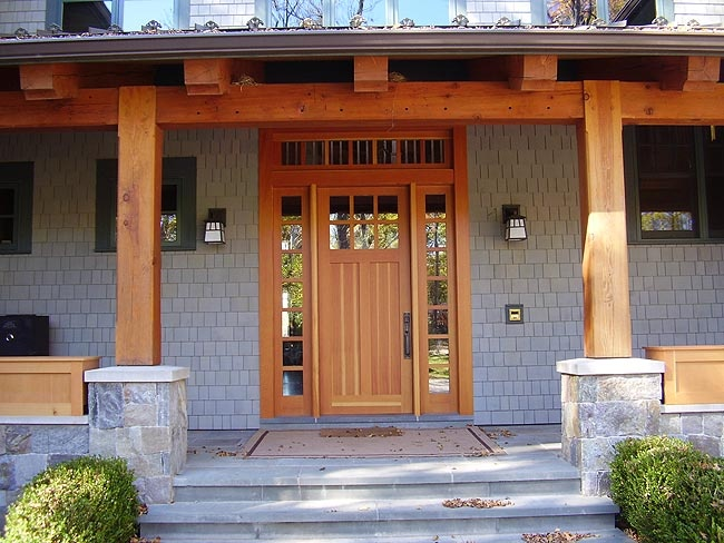Timber frame porch entrance with a custom wood door for Porch door and frame