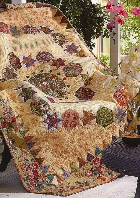 """Double bed size quilt - 64"""" x 74"""". Hexagon stars in a medallion setting featuring an oval framed print in the centre. Surrounded by a sawtooth border with lots of English piecing over paper and applique. Great scrap project for lovers of antique-style quilts. http://www.etsy.com/listing/69434198/hexagon-magic-quilt-pattern?utm_source=CraftCult_medium=api_campaign=api"""