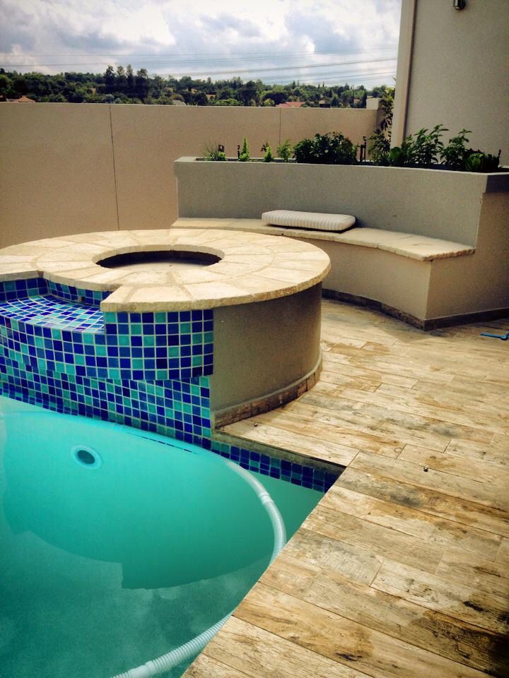 Fire pit and pool water feature with go a bench and veg planter