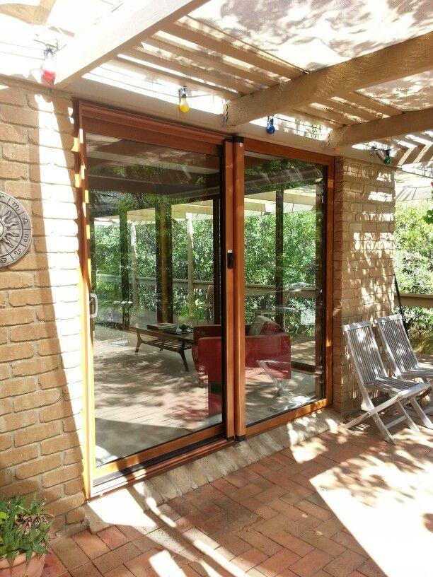 Double glazed sliding door in golden oak